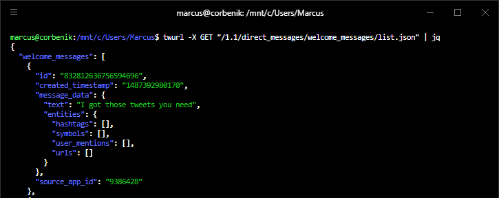 A screenshot of a Windows terminal. A command has been run and the image depicts the output. The command is a utility called twurl and a GET request is being made to the welcome_messages API endpoint. The output shows a list with one item which is the automated message that this post has been describing. The nightmare is finally over.